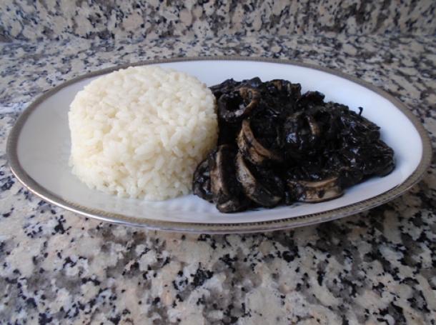 Resultado de imagen para calamares en su tinta con arroz blanco